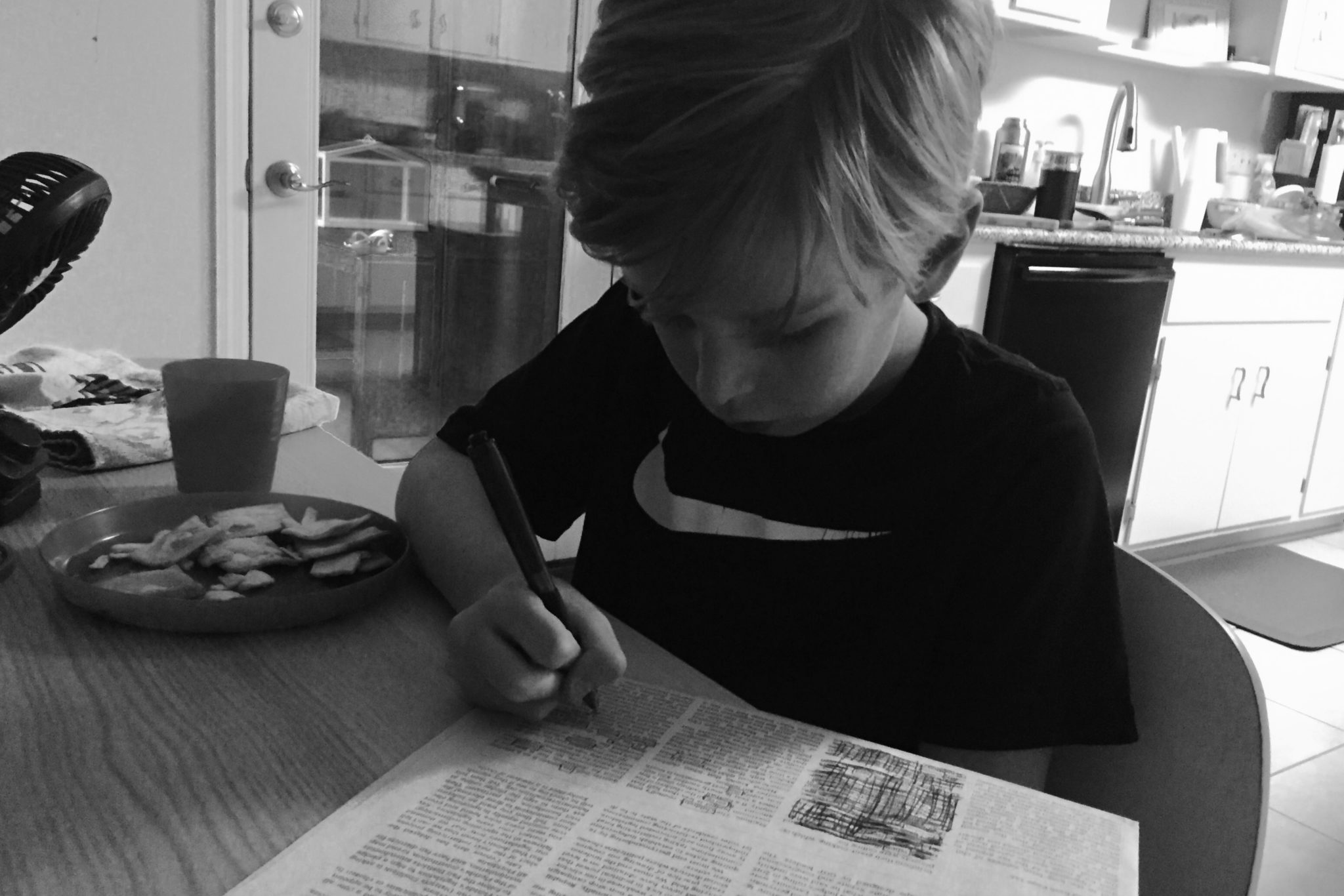 Avett making a his first blackout poetry.